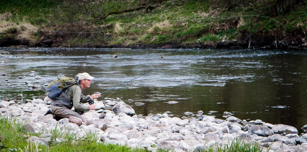 Keeping low to the water, Paul Procter makes a cast.
